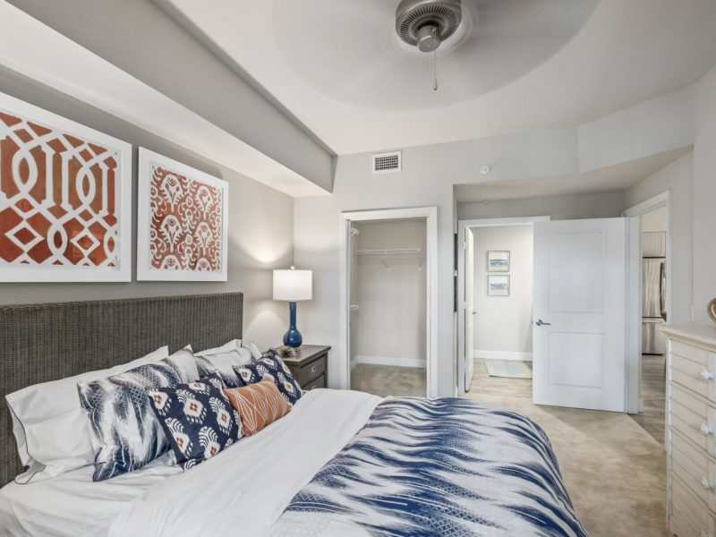 This image shows the premium feature in the bedroom area with the modern touch of fabrics and offers a ceiling fan for a pleasant ambiance. This area was also accessible to the closet, living room area, and to the bathroom that will surely make the resident comfier.