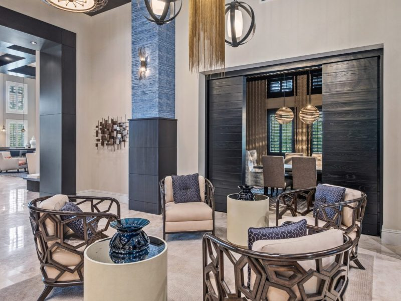 This image shows the business center in TGM Harbor Beach Apartment with luxurious sitting chairs in front of the center to give a relaxation touch to every resident.