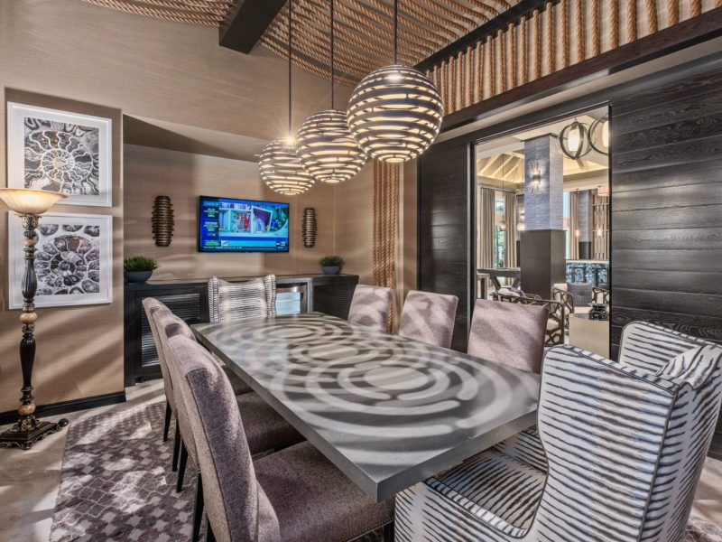 This image shows the view inside the business center in TGM Harbor Beach Apartment with luxurious items of furniture and light effects to the area.