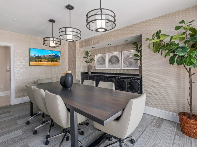 This image shows the conference room in TGM Harbor Beach Apartment, featuring the spacious area and minimalist decors that was ideal for business purposes.