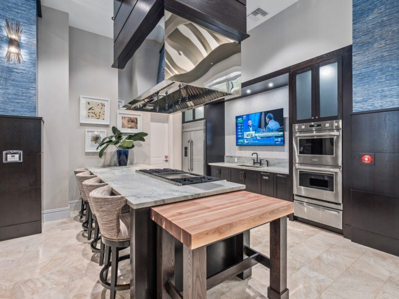 This image shows the view inside the gourmet demonstration kitchen in TGM Harbor Beach Apartment, featuring different kitchen equipment and a spacious area for an accessible treat.
