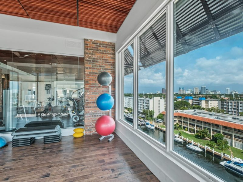 This image shows the 24-hour State-of-the-art fitness gym featuring different equipment that is essential for community amenities. The Athletic Club is also offering gym balls to test and apply proper balance.