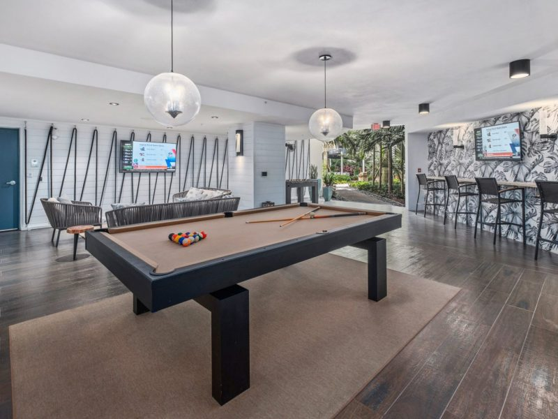 This image shows the expansive view inside the indoor billiard and TV lounge in TGM Harbor Beach Apartment featuring an ideal space for fun moments with friends and family.