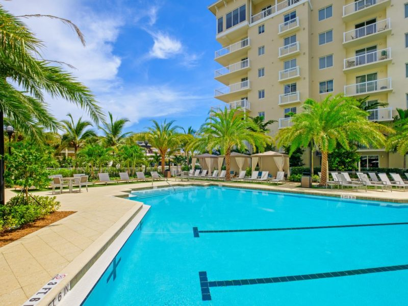 This image shows the resort-style outdoor swimming pool with a glittering sky blue water that was admirable for the fun bond with friends and family.